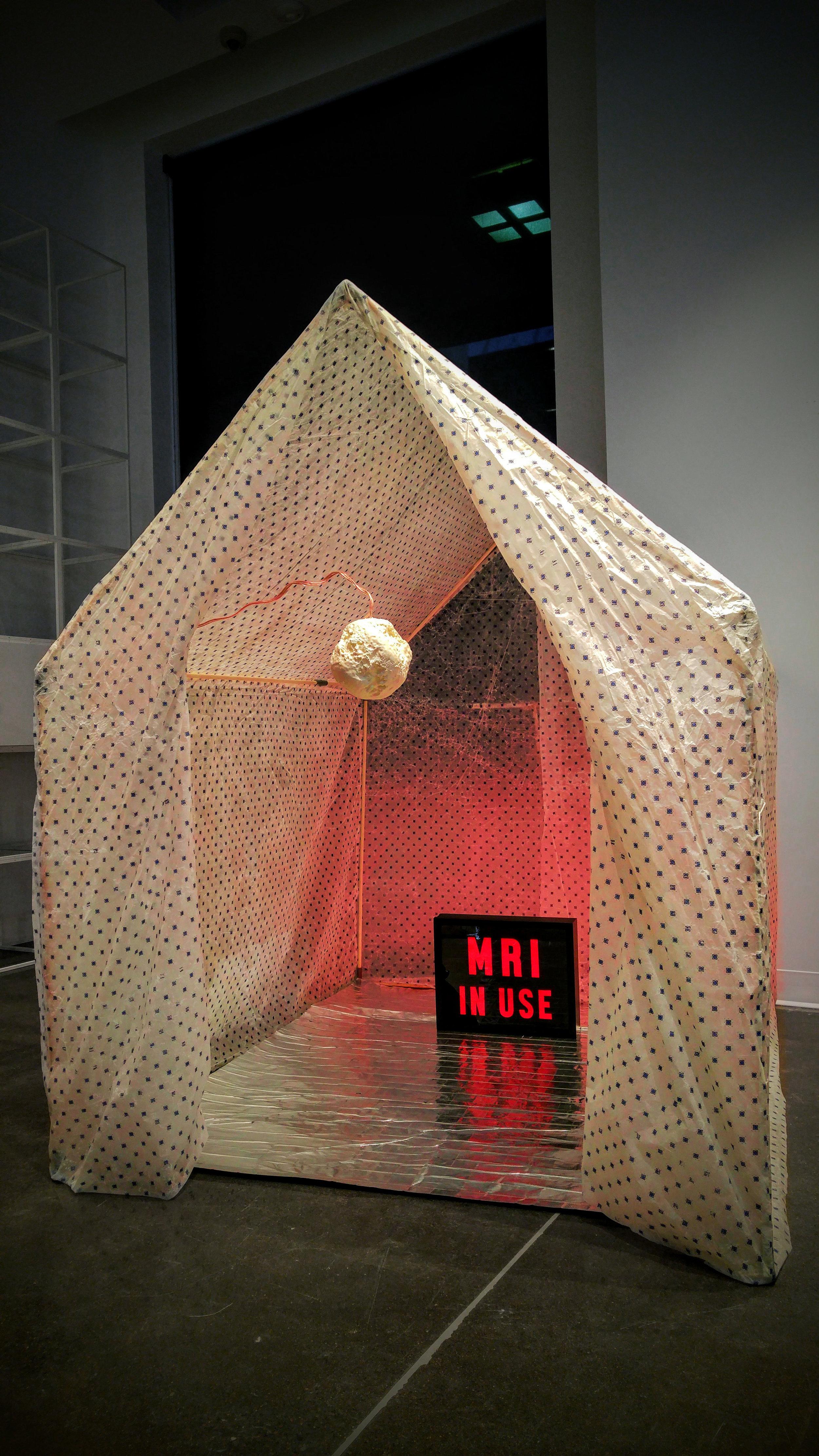 """Healing House I,"" Beeswax, silk, light box, vibrational sound, 60"" x 60"" x 65,"" 2018"