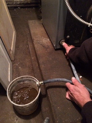 HM drains many buckets of rusty water.