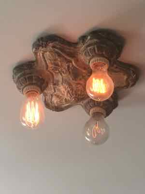 As soon as we closed on our house, I started collecting old light fixtures from flea markets. HM was not pleased. But now he proudly shows off the results – like this one in our living room – AS IF IT WAS HIS IDEA.