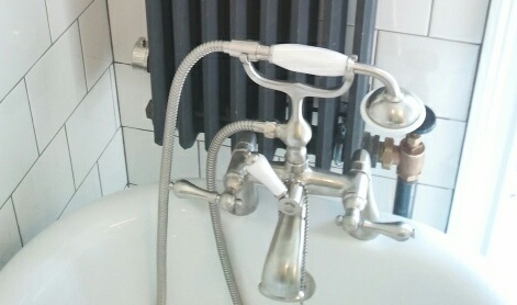 The diverter is that handle in the middle that diverts the water from the faucet to the telephone sprayer.