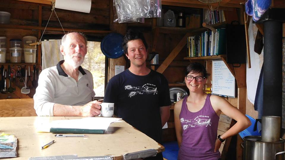 2016 Field Staff, James MacKinnon and Viv Pattison, model our shirts in the LBCS cook cabin on East Limestone Island with co-founder and longtime friend Tony Gaston.