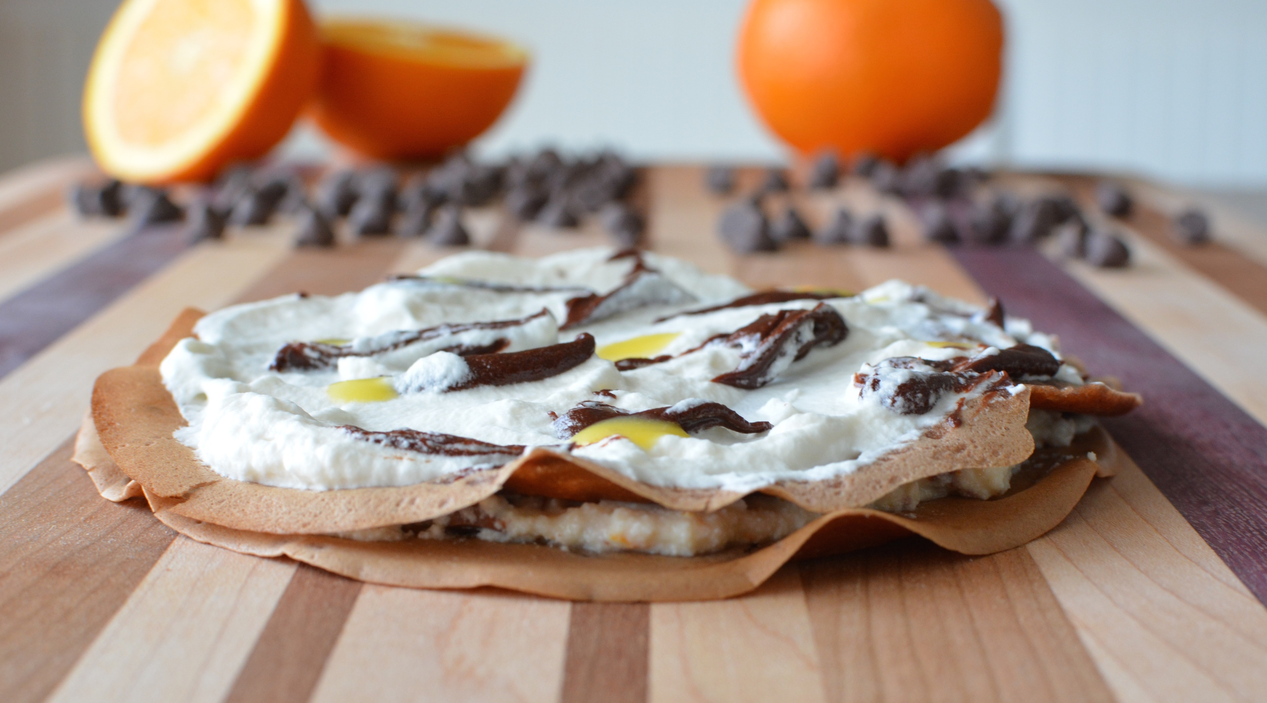 Two base layers of crepe and filling with a small amount of ganache and orange cream sauce