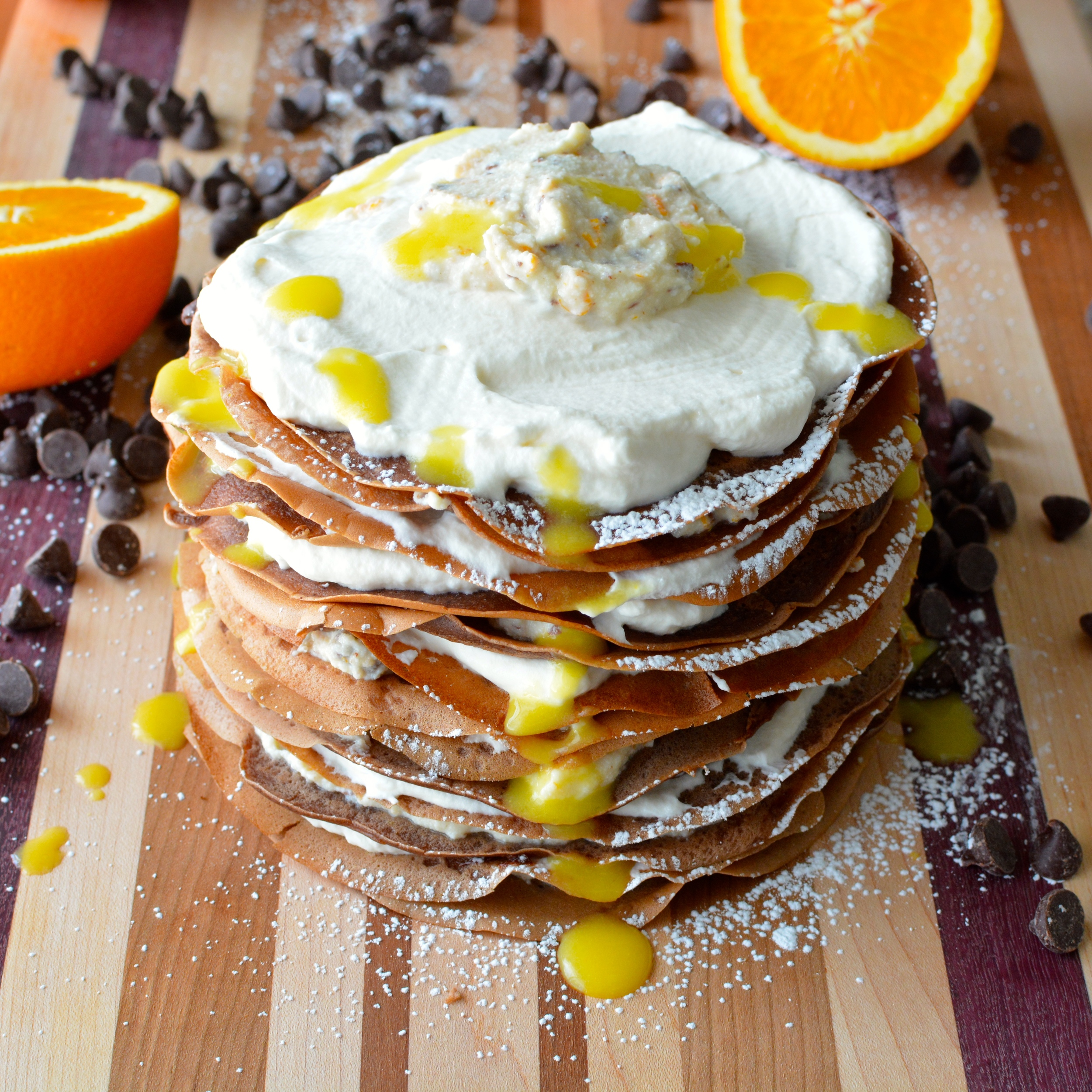 Chocolate Cannoli Crepe Cake with Vanilla Whipped Cream, Orange Cream Sauce and Chocolate Ganache