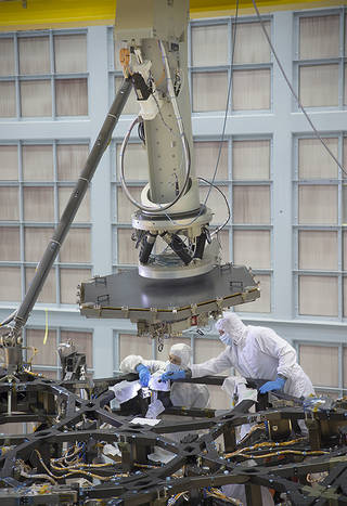 Inside a massive clean room at NASA's Goddard Space Flight Center in Greenbelt, Maryland the James Webb Space Telescope Team prepared for the first flight mirror's installation onto the telescope structure.   Credits: NASA/Chris Gunn