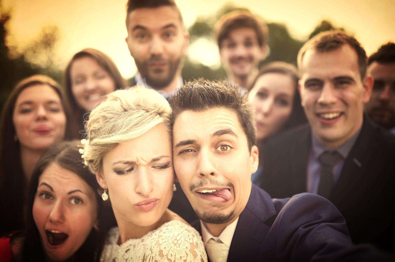 bigstock-Newlyweds-with-friends-taking--72646420.jpg