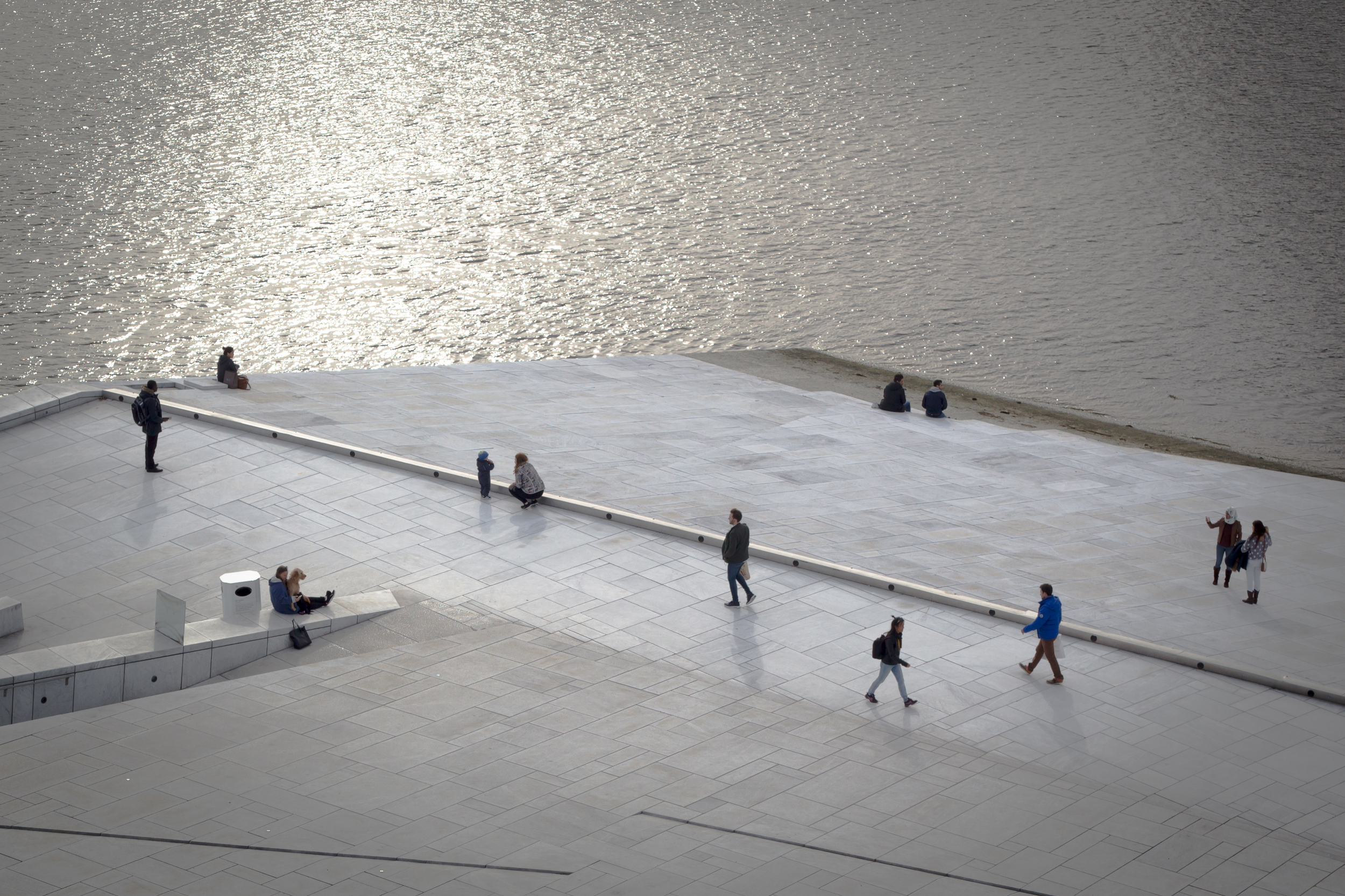 Visitors walking on the Opera House in Oslo