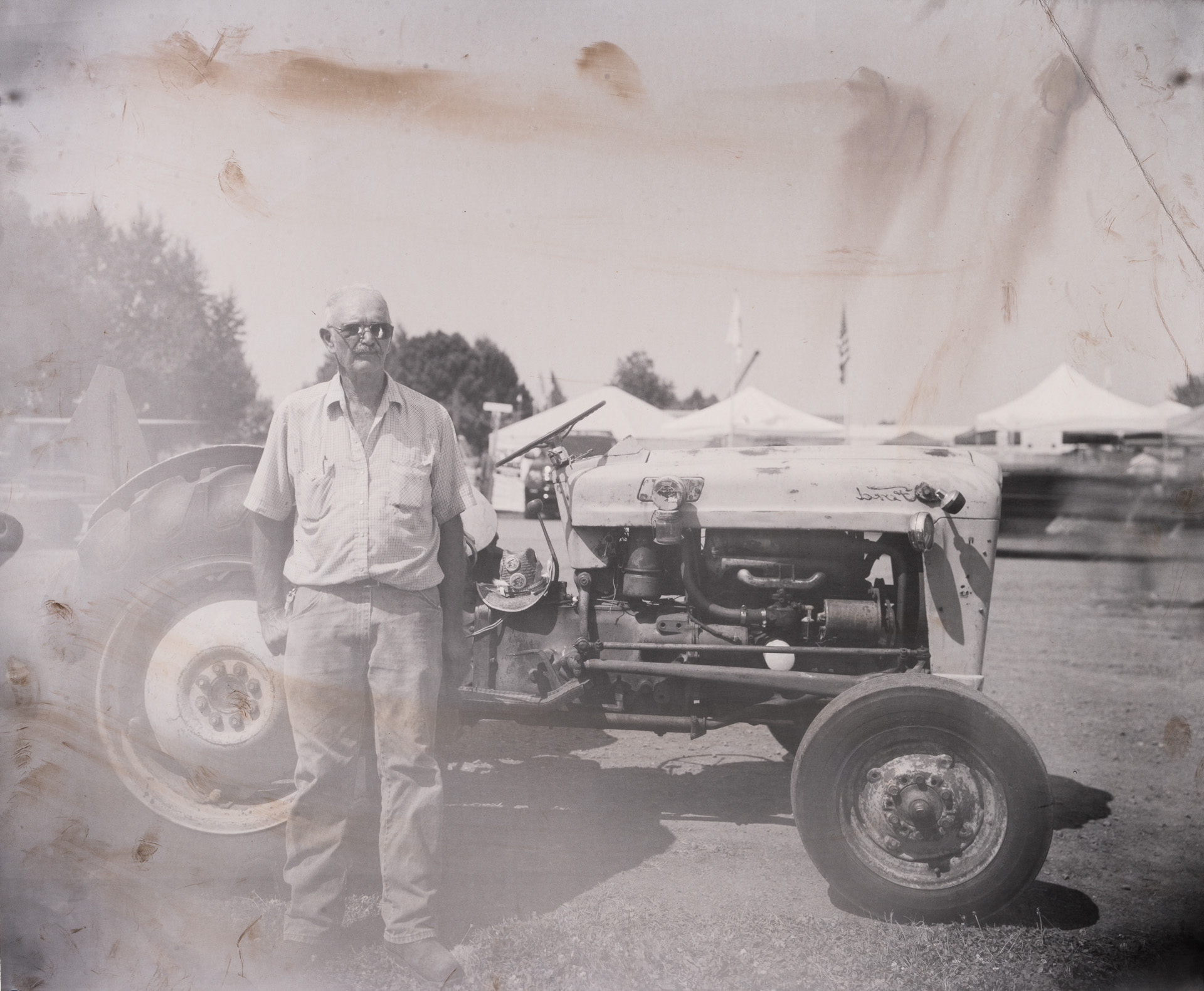 Retired printer James King and his favorite tractor that was owed by his father. Photo ©2018 Stephen Takacs Photography