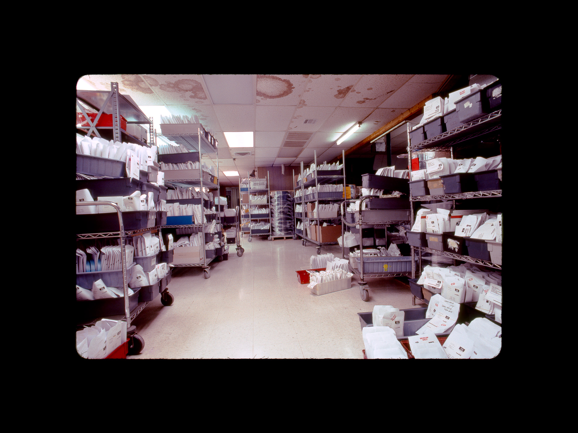 The mailroom overflow at Dwayne's Photo on December 29, 2010. During the final week of Kodachrome processing, Dwayne's received more film in the mail than they would have normally received in an entire month. Photo ©2010 Stephen Takacs