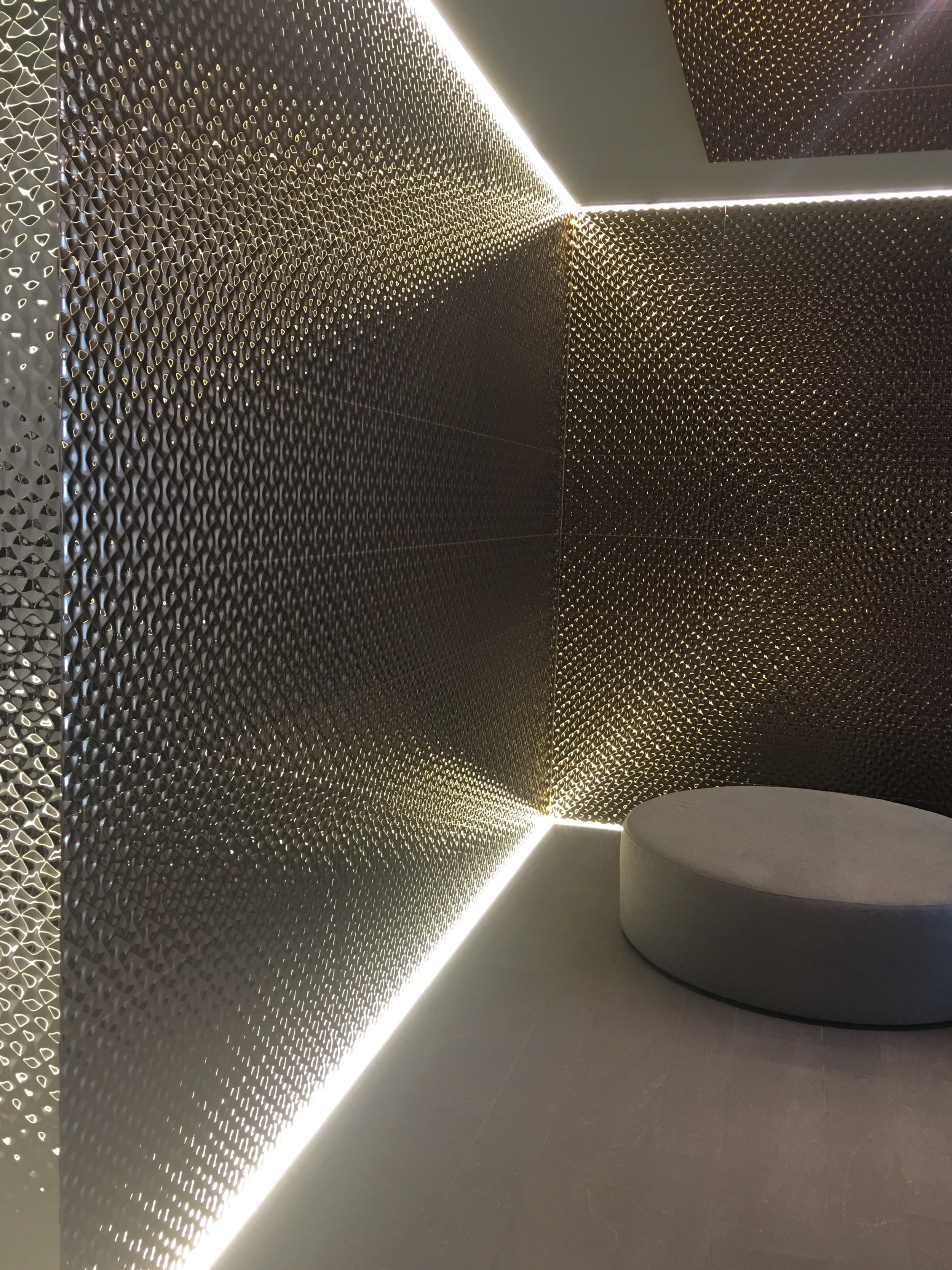 Striking geometric wall tile, with recessed lighting to highlight the design features