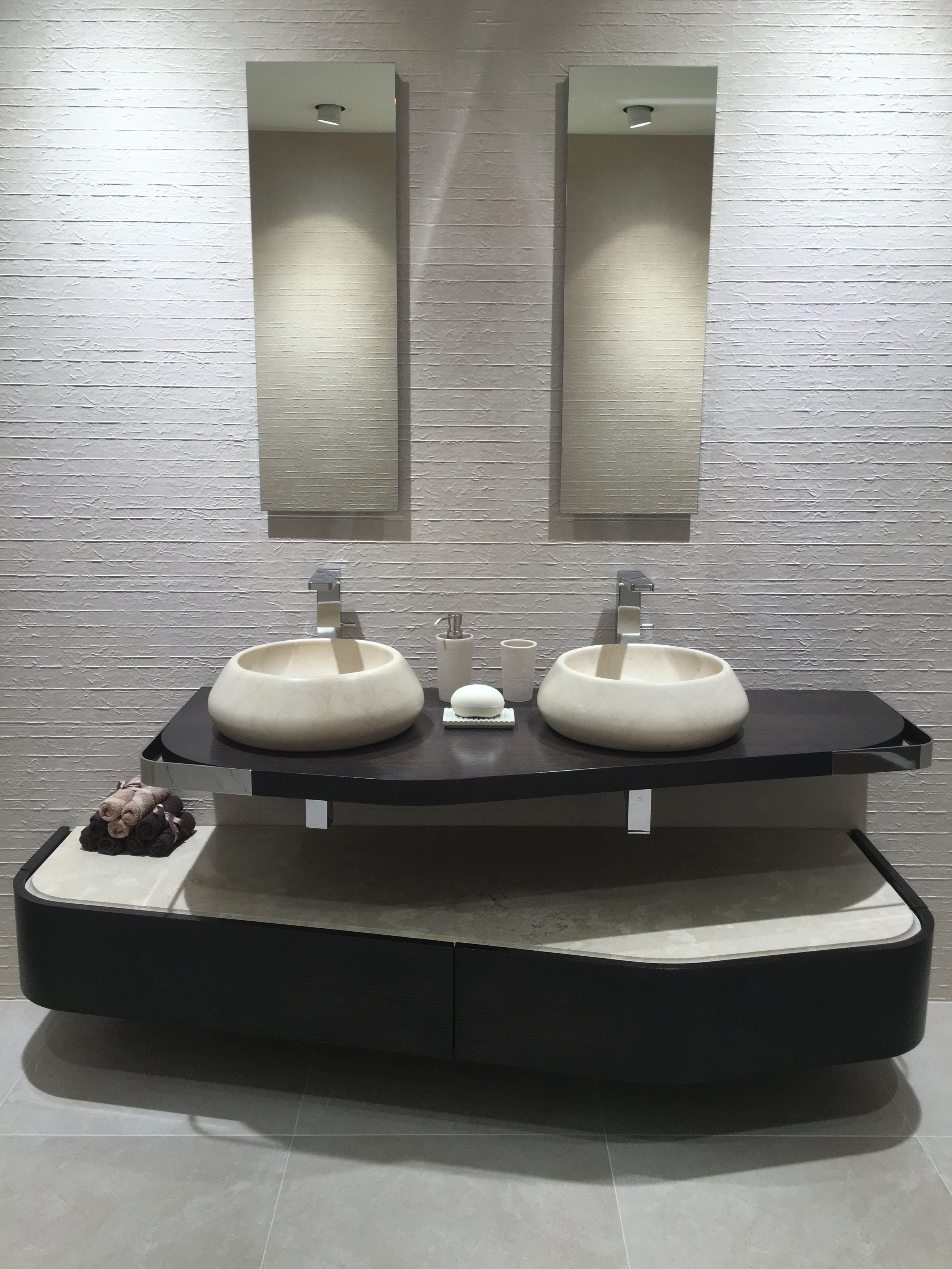 Couple's sinks with asymmetric detail and beautifully shaped bowls