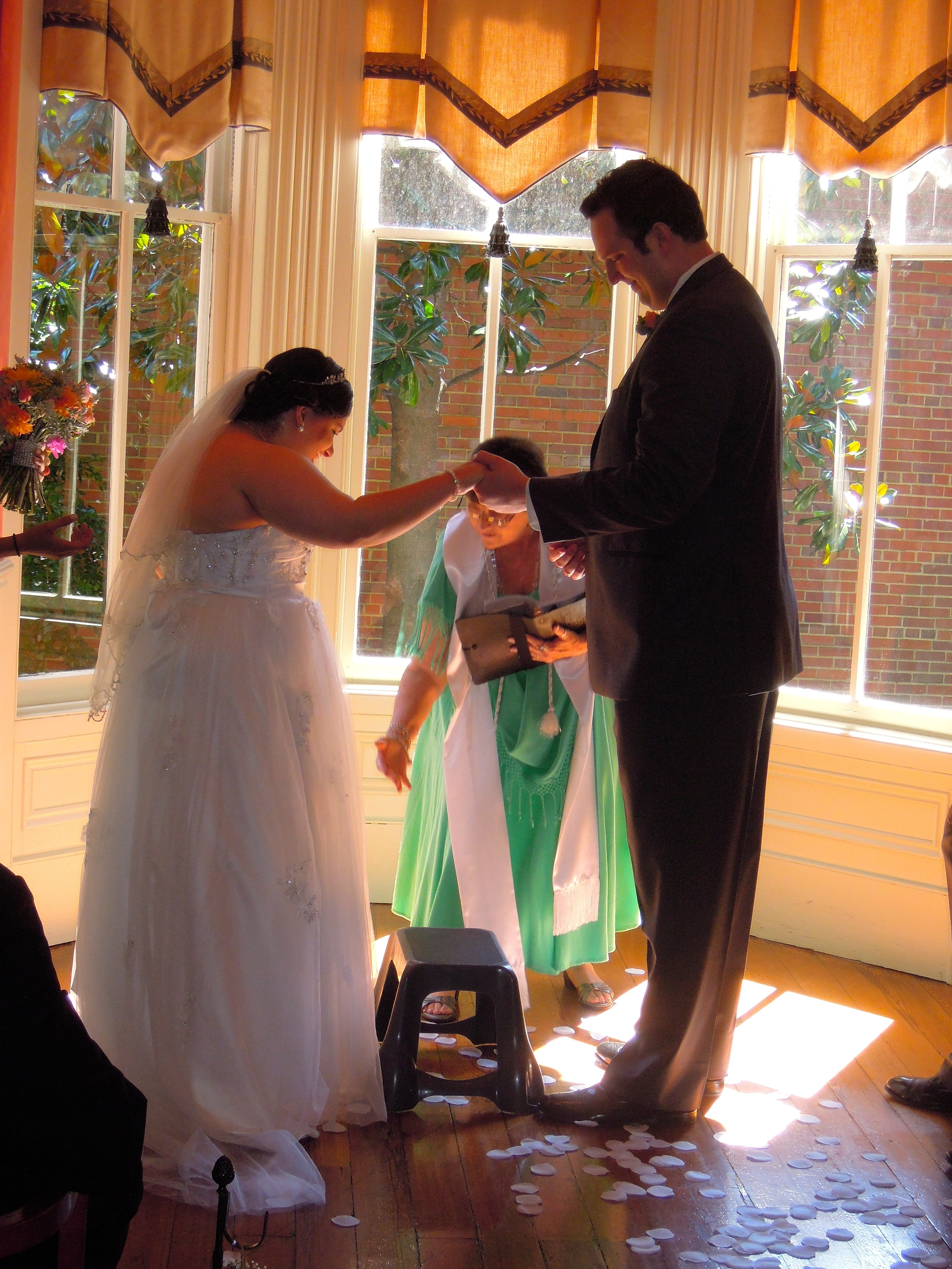 Bride stepping up onto stool for the kiss!