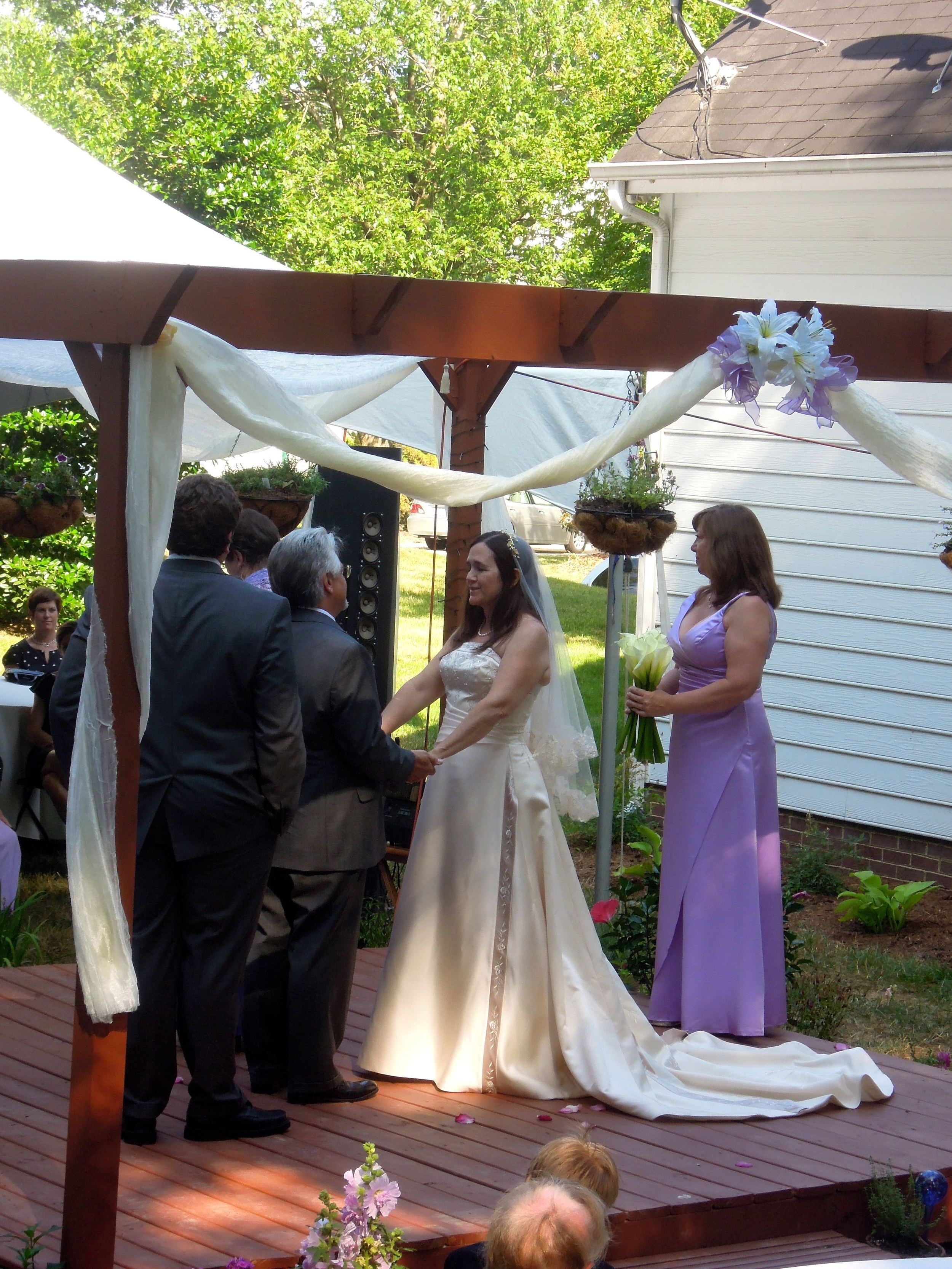 Kelly and David built a gazebo for their backyard just for the wedding surrounded by their families and friends.