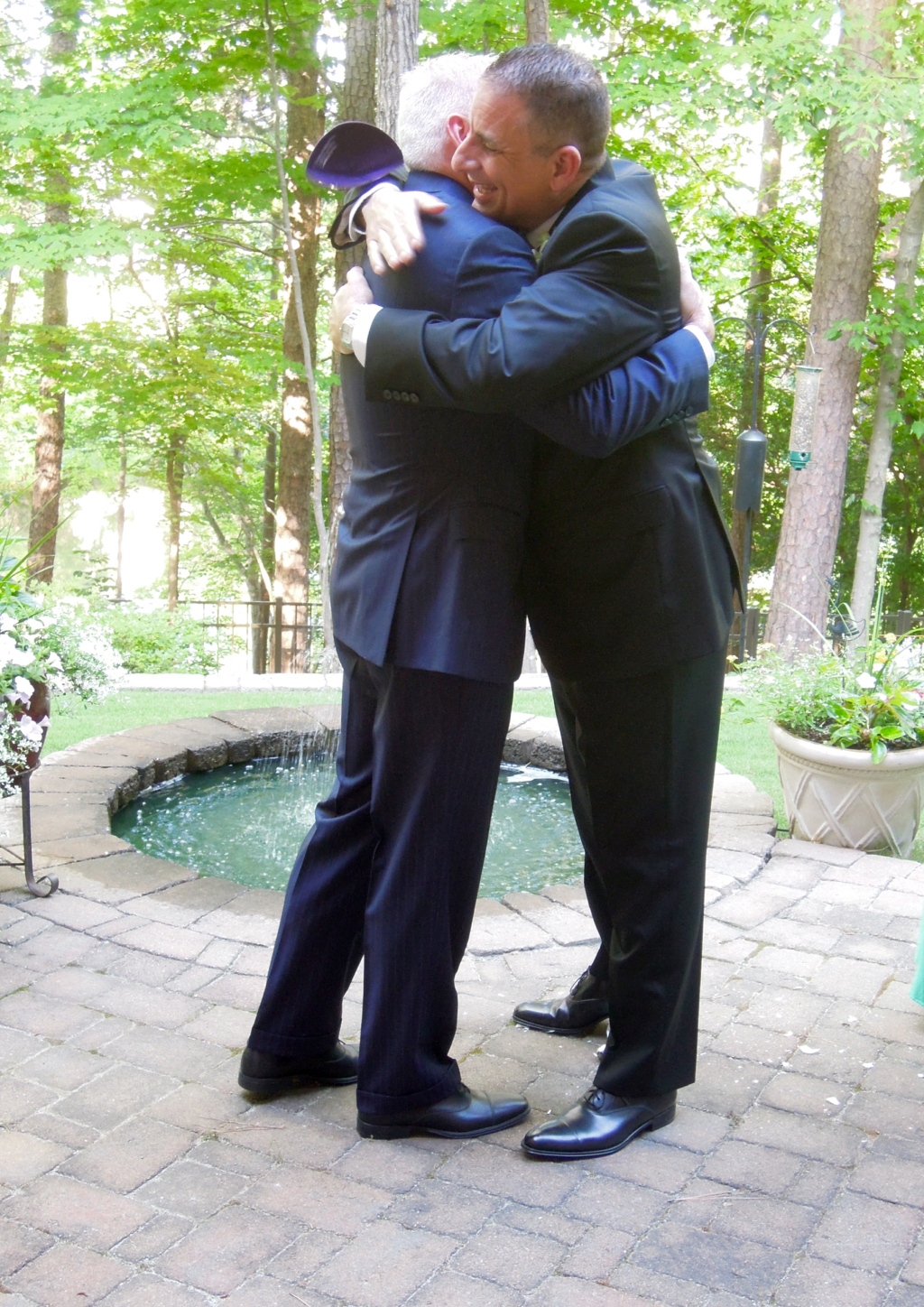 The yarmulkes went flying during the hug!