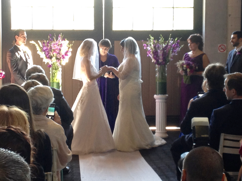 Because the wind was blowing so hard, the ceremony was moved inside the horse barn. Their horse Rebel was in the stall next to us!