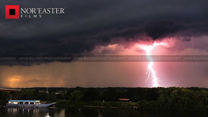 Massive lightning strike impacts somewhere to the west of Watervliet, New York as captured from the Troy, New York Waterfront.