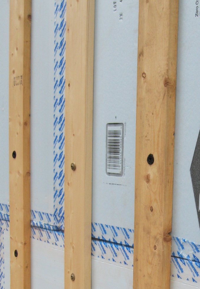 Nailer strips attached over foam board insulation on the exterior of the building.