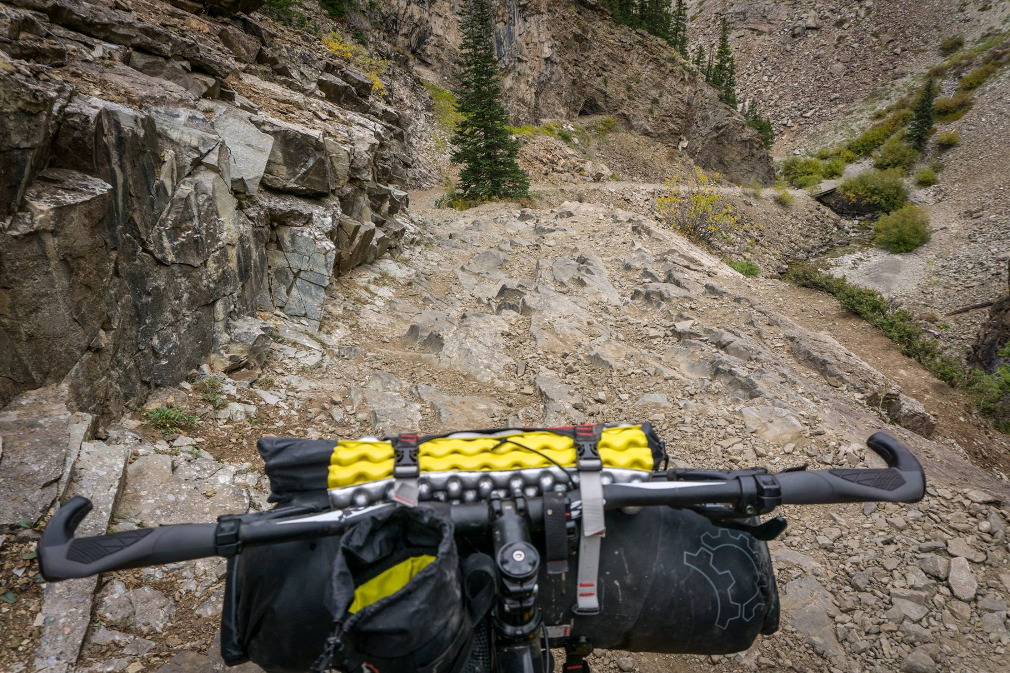 Simple cockpit before I got a fancy phone mount and wireless speaker. Headed down Schofield pass in Colorado. That foam dooohickey is a fold up seat, which I ended up using 0 times, but they come in hand during colder months to prevent freezing your butt off.