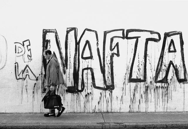 Man on sidewalk in Nikes. Copyright:  Woody Wood  on flickr ( CC BY-NC 2.0 )