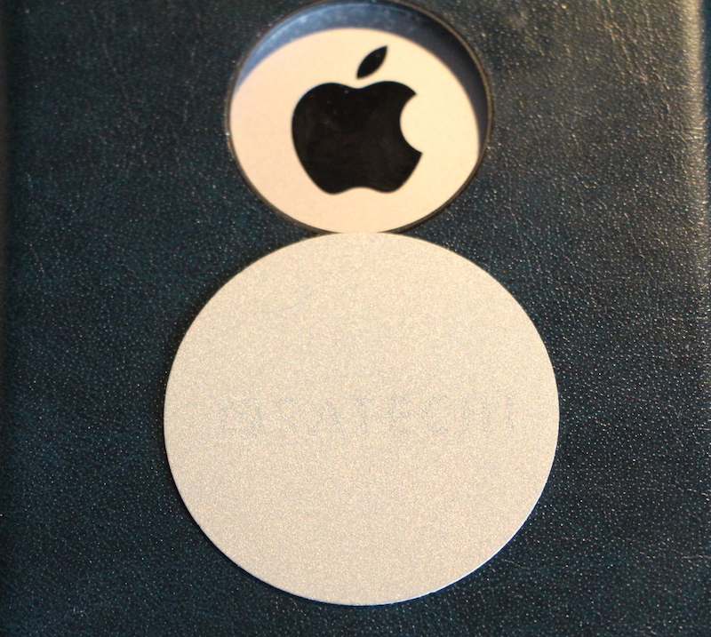 THE METAL DISC THAT CAN BE ADHESIVELY ATTACHED TO YOUR PHONE CASE