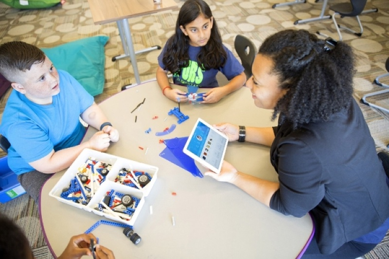 Carla Mendoza Lopez, right, with (L-R) Mason Mulkey and Amrutha Mantha, use IBM Watson Element for Educators, the first IBM MobileFirst for iOS app for the education industry, at Coppell's Richard Lee Elementary School in Coppell, Texas, on Weds., October 19, 2016. Coppell Independent School District, one of the top ranked public school systems in Texas, is the first school district to use the app for enhanced personal interactions and learning experiences for students. (Courtesy of IBM)