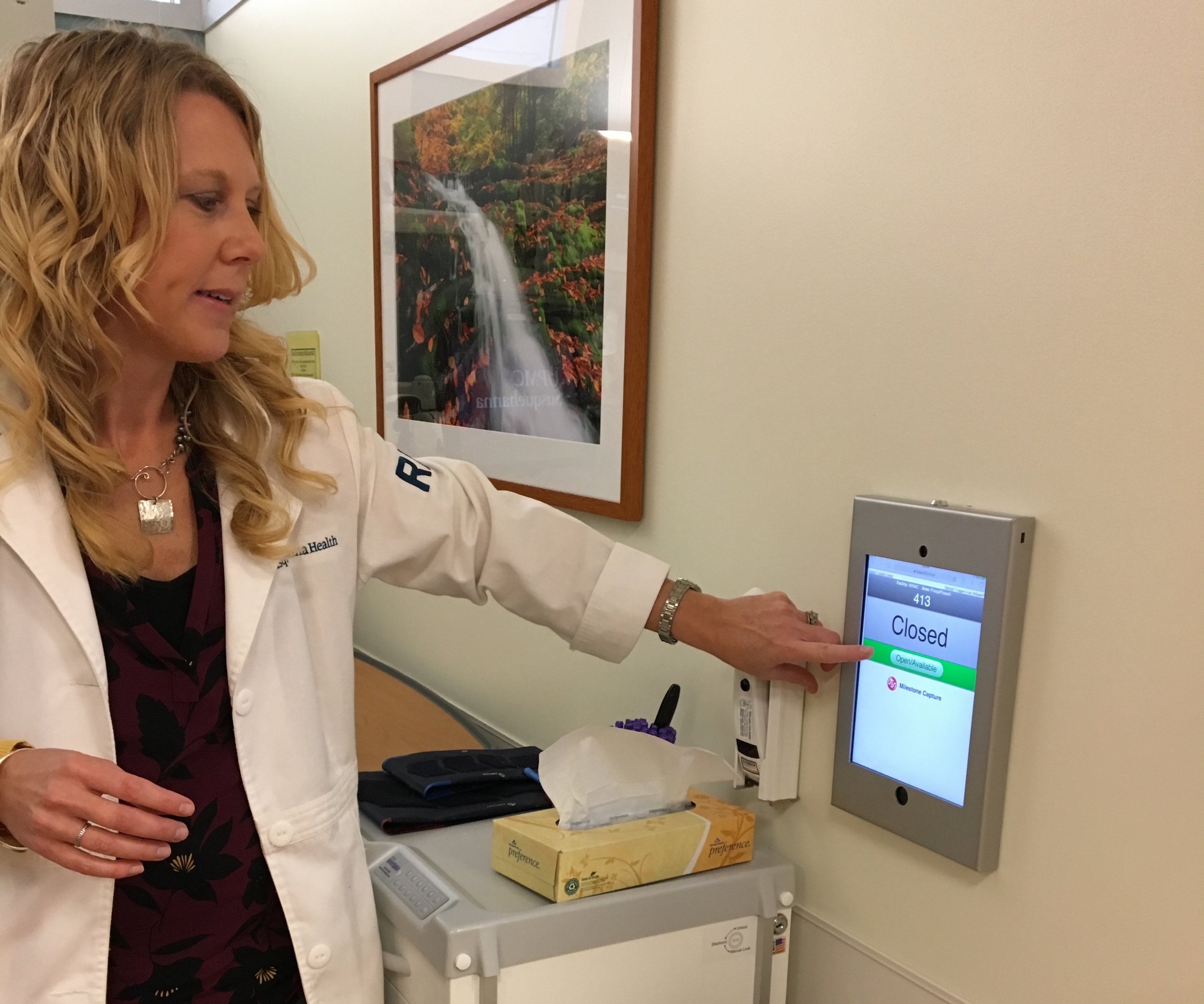 Surgery Center and Extended Care Unit Patient Care Manager Deanna Shamsie, RN, BSN, demonstrates the use of the iPad on the unit.
