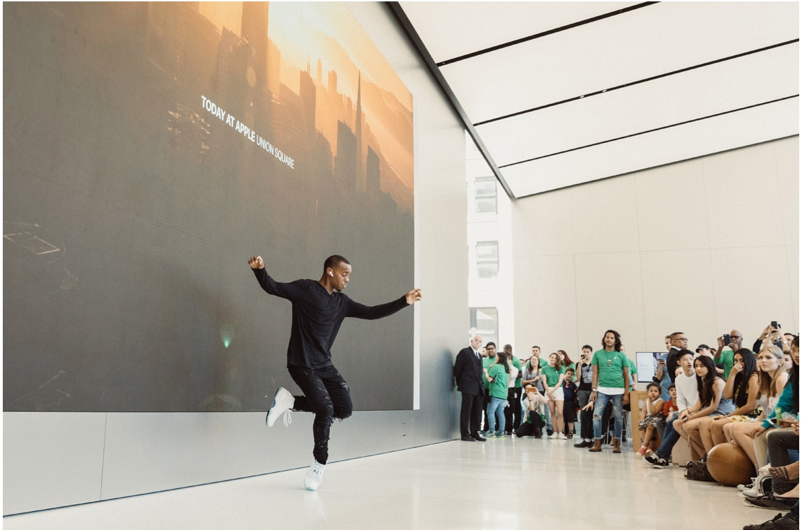 Movement artist and star of Apple's AirPods commercial, Lil Buck, shows off his moves in the Forum at Apple Union Square.
