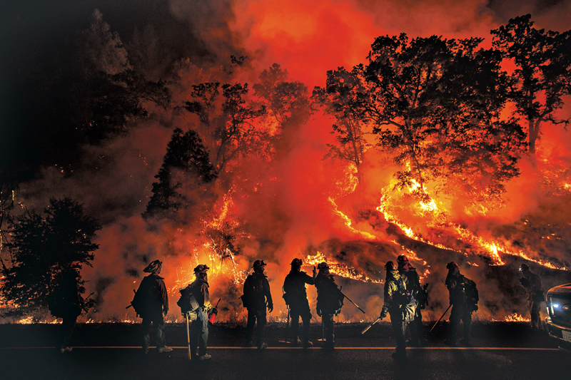 Flames from the Valley Fire cover a hillside along Highway 29 in Lower Lake, California September 13, 2015. The swiftly spreading wildfire destroyed hundreds of homes and forced thousands of residents to flee as it roared unchecked through the northern California village of Middletown and nearby communities, fire officials said on Sunday. REUTERS/Noah Berger TPX IMAGES OF THE DAY