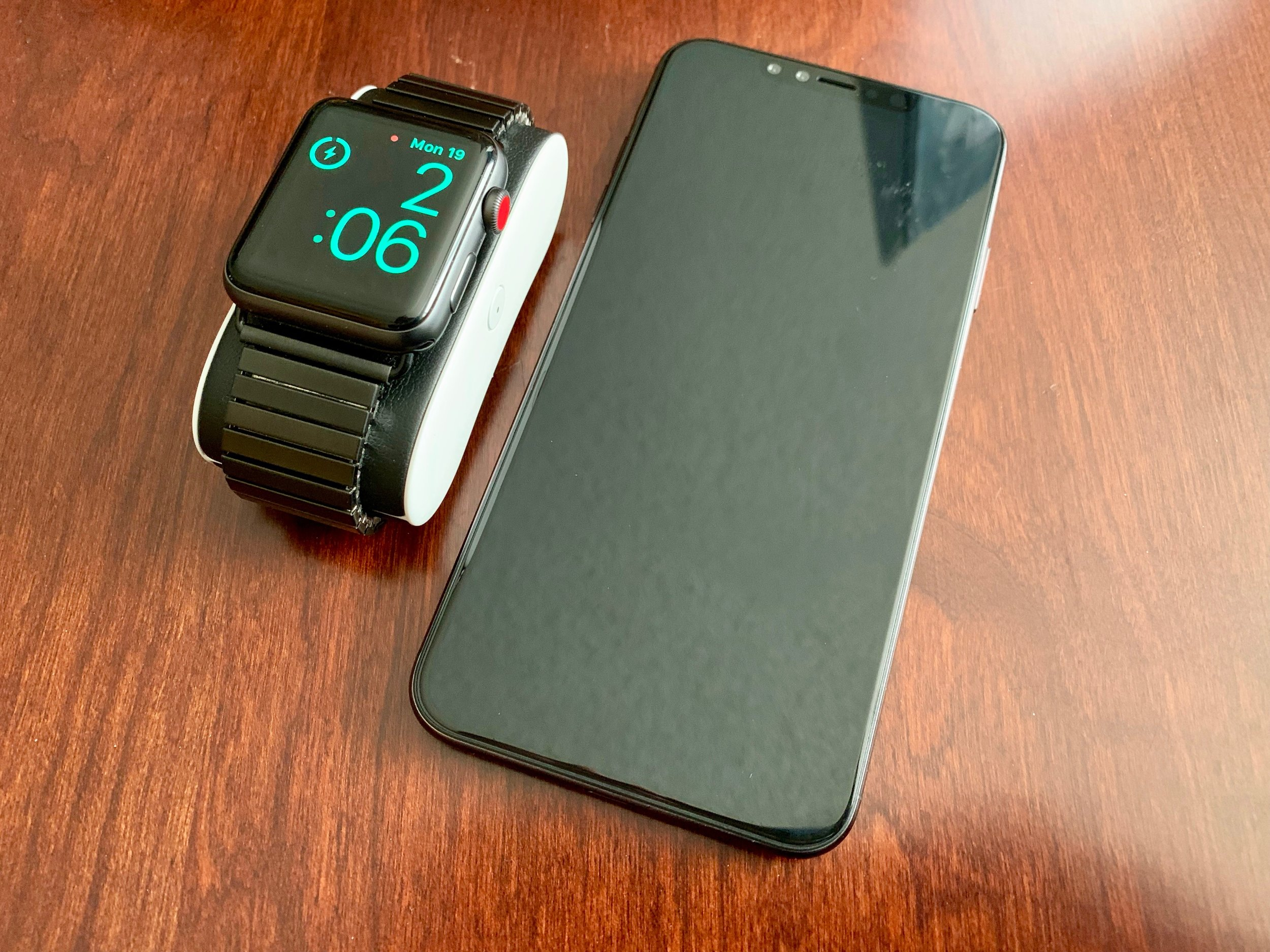 OPSO charger (left) with an iPhone XS Max mockup (right). Photo ©2018, Steven Sande