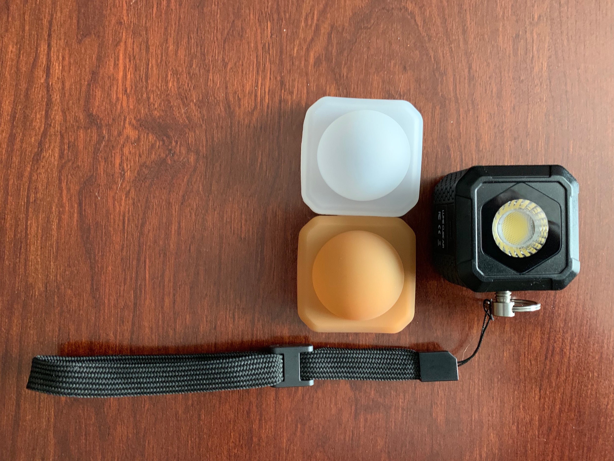 Lume Cube Air with accessory hand strap and diffusors.
