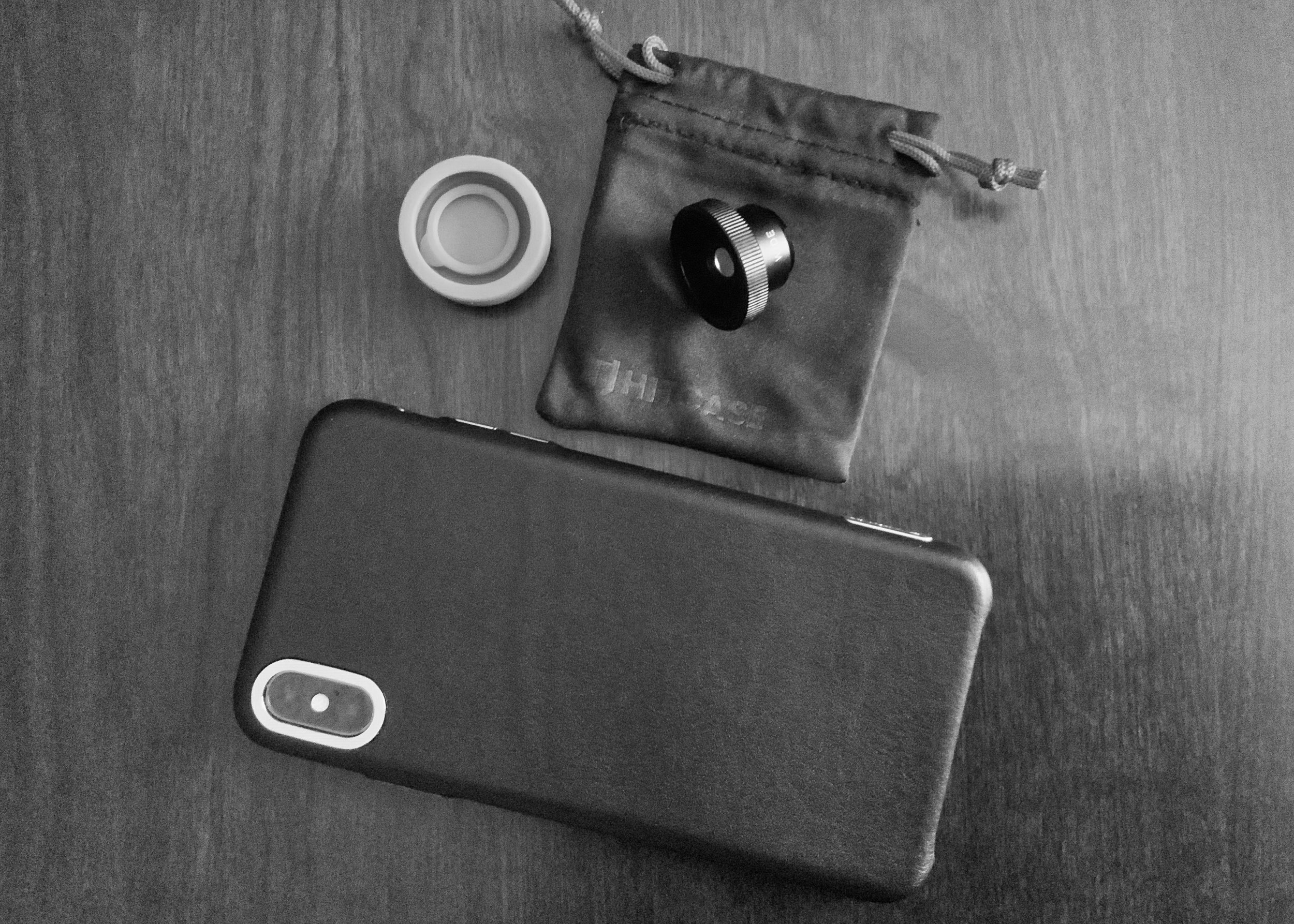 Hitcase Ferra case (in black leather) and TrueLUX Wide Lens.