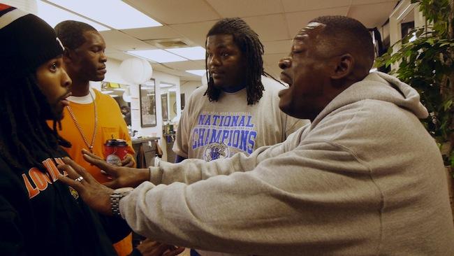 Barbers Robert Boone (right) and Mark Wagner Jr (left) debate college hoops in Louisville.