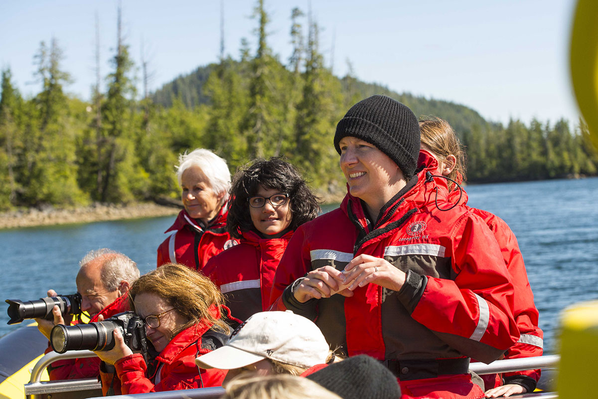 A guide with some happy guest on a whale watch in Tofino, BC.