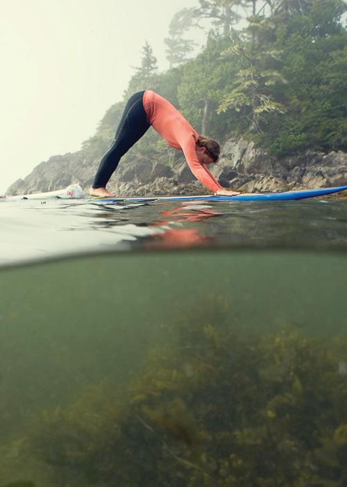 Sup Yoga - Woman doing downward dog yoga post