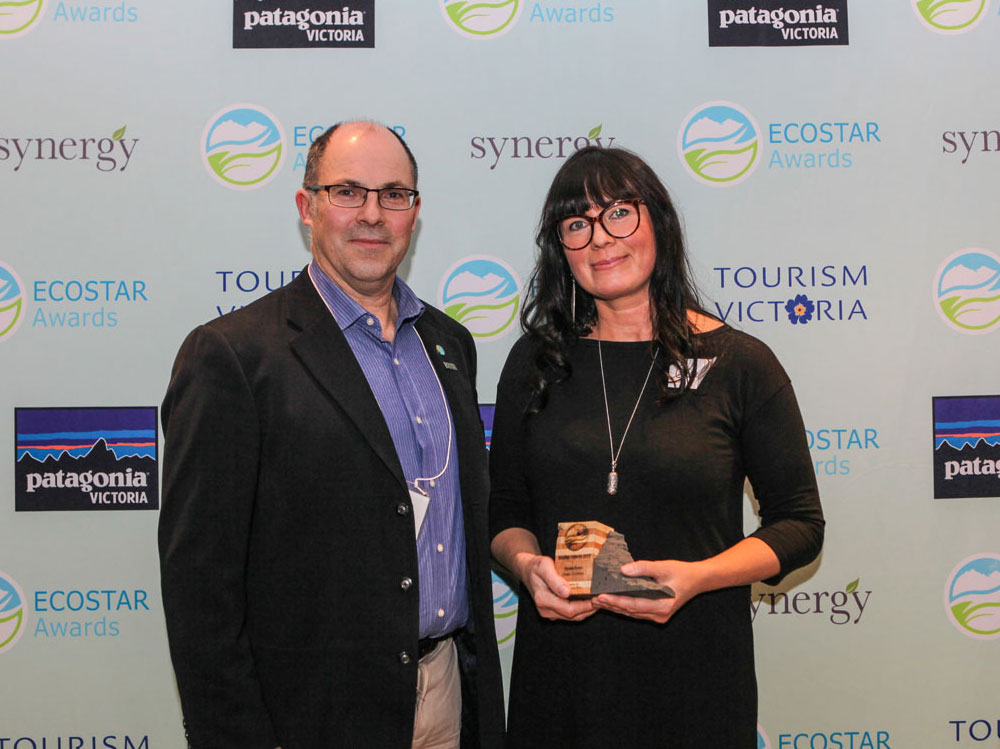 Ocean Outfitters General Manager receiving an Ecostar Award.