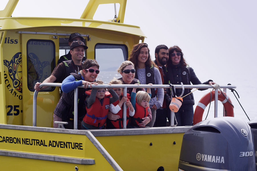 Group on back of deck on a private whale watching tour.