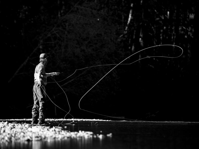 Fly Fishing in a river near Tofino, BC.