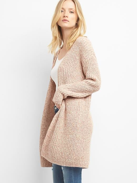 This sweater runs TTS! I purchased mine in the stone color in a size small.