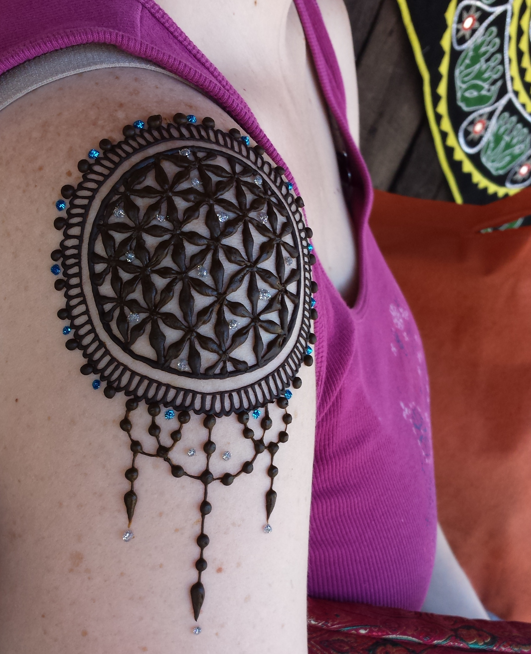 Shoulder epaulet-style design with the seed of life pattern