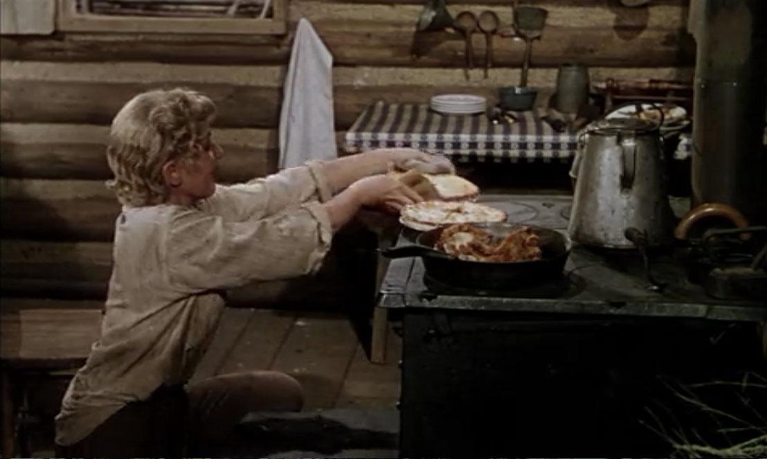 Marian Starrett (Jean Arthur) in  Shane  (1953) in her Wyoming frontier kitchen, circa 1889.