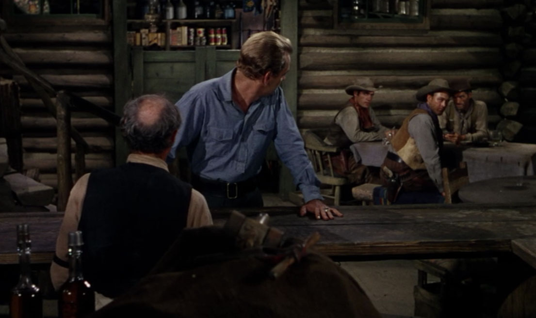Shane (Alan Ladd) first meets Chris Calloway (Ben Johnson) in  Shane  (1953) .  Catches shit for not ordering whiskey.