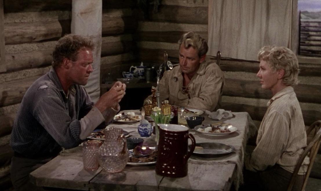Joe Starrett (Van Heflin), Shane (Alan Ladd), and Marian Starrett (Jean Arthur) in  Shane  (1953).