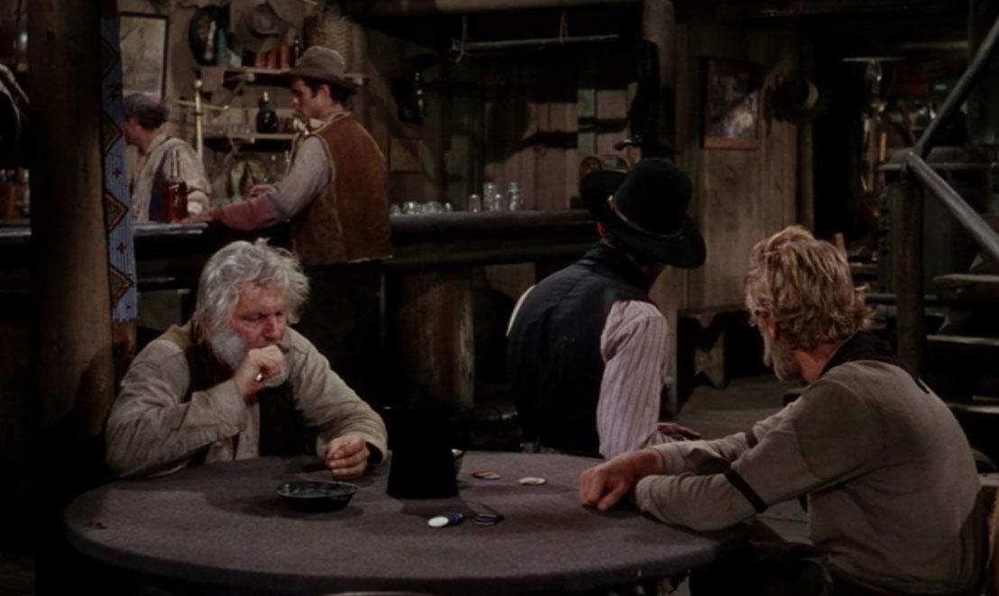 "Back, bartender Will Atkey (John Miller) and Frank ""Stonewall"" Torrey (Elisha Cook, Jr.)"