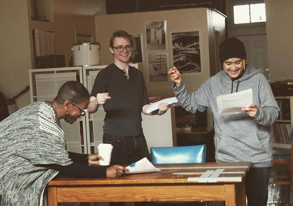Company members Shariba Rivers, Andrew Cutler, and Avi Roque working through new pages in rehearsal.