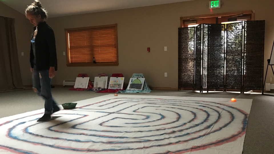 A Crossing the Threshold participant in Denver, CO walks the labyrinth.