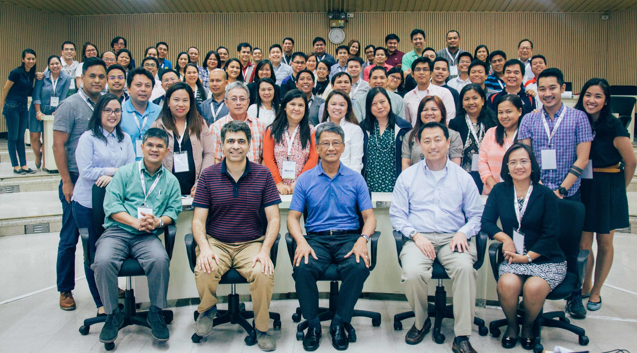 Participants, lecturers, and organizers pose for a group photo at the end of the successful bootcamp.