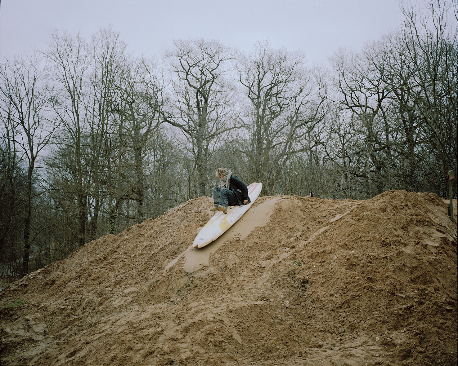 'Hole' surfs down a hill of mud.