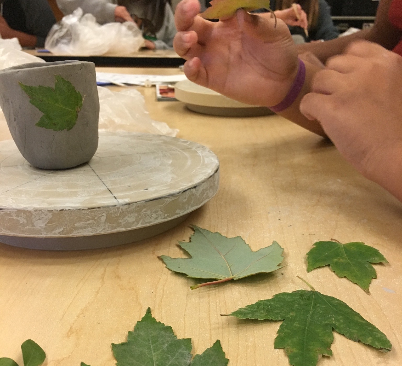 Students Experiment with texture for the first clay project of the year - pinch cups!