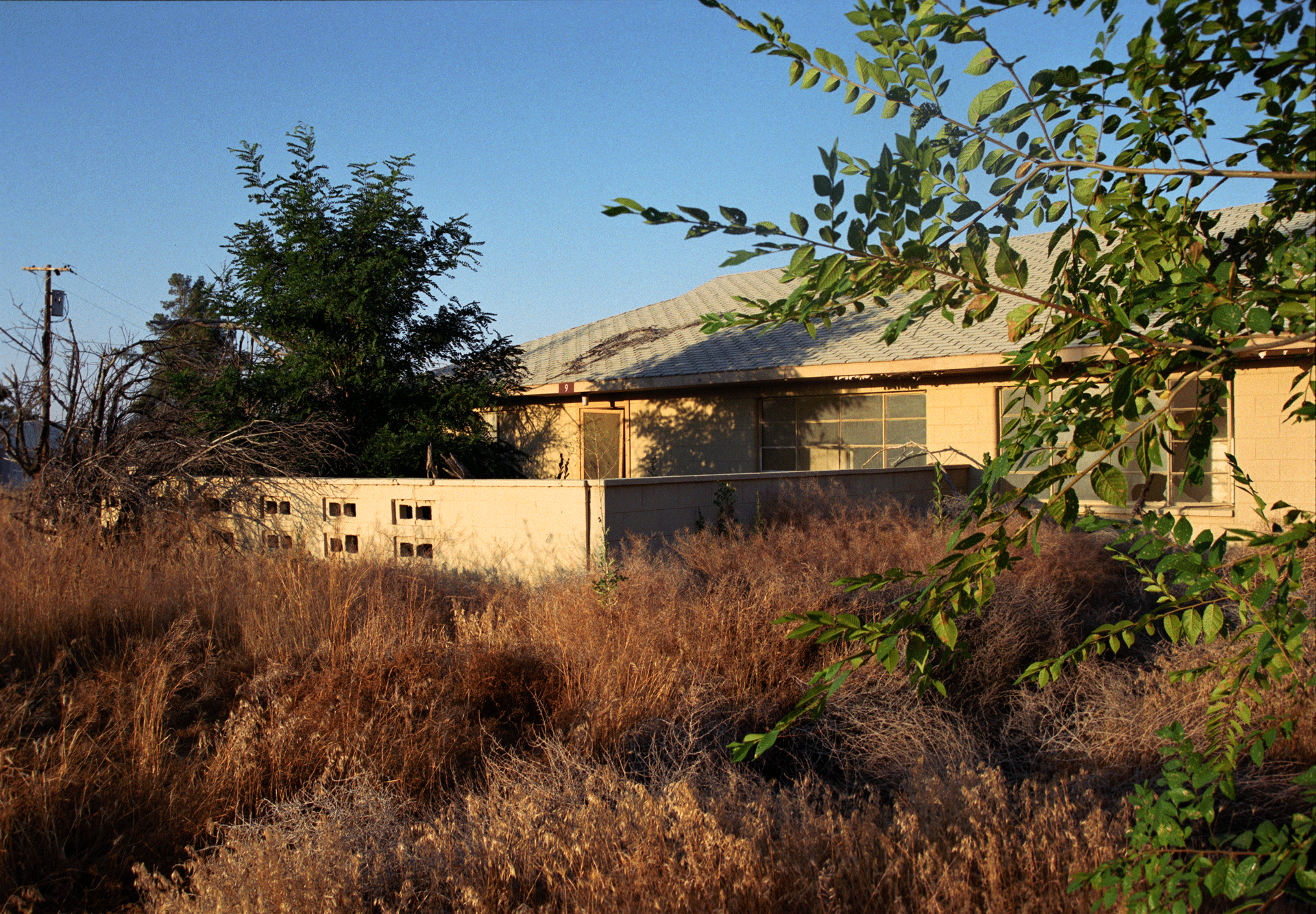 "Decommissioned (House with Garden). 2006/2011. C-Print, 10x8""."