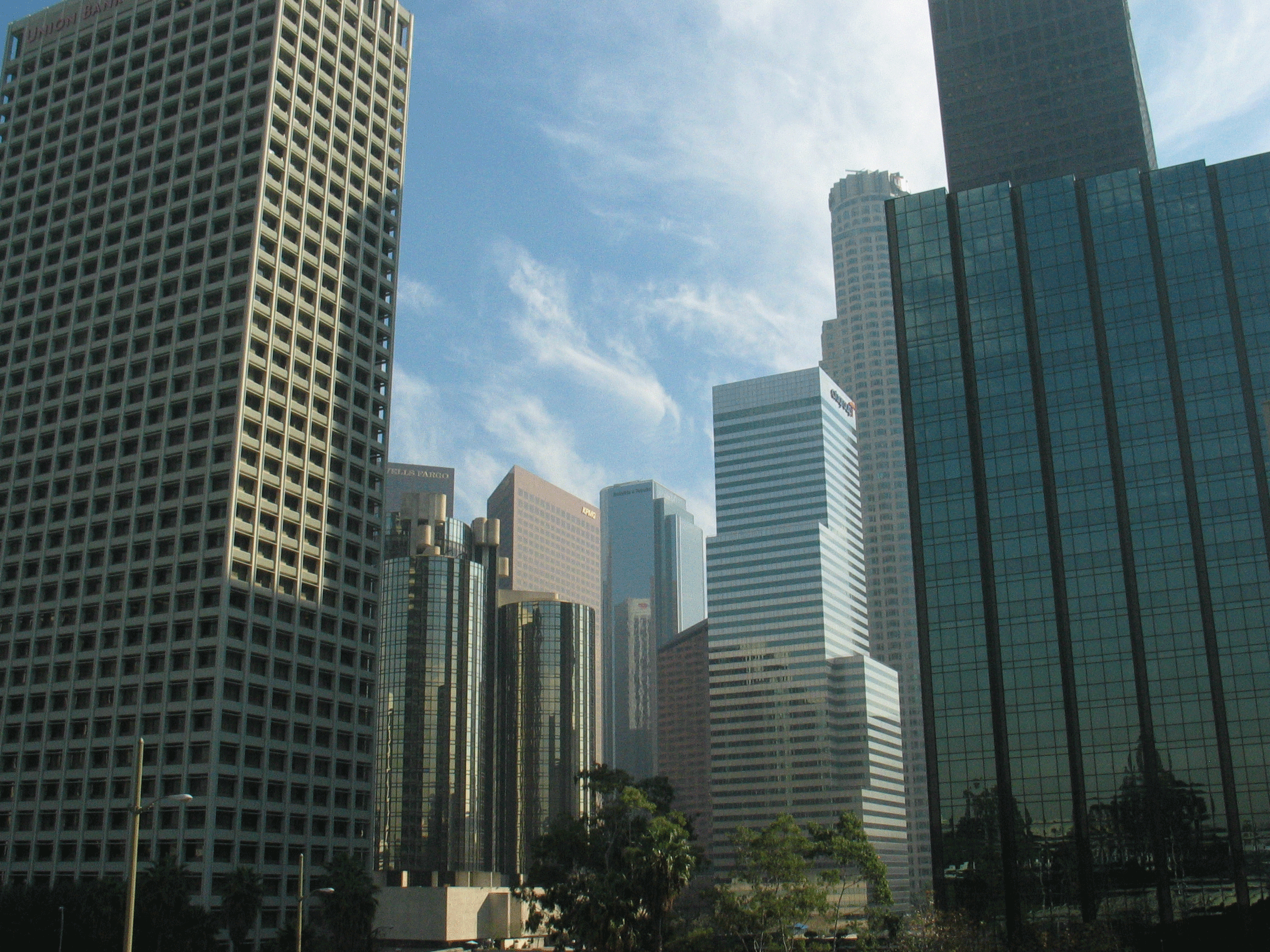 6.  Mirrored glass on skyscrapers acts very similarly within the context of landscape. In this situation, the mirrored skin of the skyscraper reflects the sky and other buildings. This suggests that the building itself produces copies of other buildings like a spectrum of landscape eidolon.