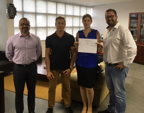 (from L to R) Mike Thwaites, IIJ's Global Sales Manager, Dudley Cherry, Nadina Hnatiw, IIJ's Account Manager for Traderplus, and Willem Smit, Chief Financial Officer, of Traderplus at the latest contract signing in South Africa